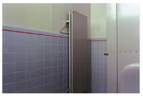 los alamos portfolio, 1965-74 [cousin] [bathroom stall/coathangers] by william eggleston